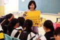 About 97 per cent of teachers said they required Primary Three and Six pupils to buy an average of three extra TSA exercise books. Photo: SCMP
