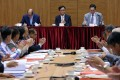 Chairman Kenneth Lau Ip-keung (centre at table) presides over a Heung Yee Kuk meeting which backed his father, Lau Wong-fat, to serve his full Legislative Council term. Photo: Dickson Lee