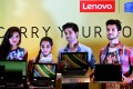 Models pose at a recent Lenovo product launch event in Bangalore, India. The firm's parent company Legend Holdings had a successful IPO in Hong Kong this week. Photo: EPA