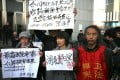 Supporters of the civil rights lawyer Xu Zhiyong protest outside the court in Beijing where he was tried for disturbing public order last year. He was later jailed for four years. Photo: EPA
