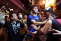 A localist protester (left) scuffles with a pro-China demonstrator during an anti-China protest at Mongkok shopping district on June 28, 2015. Photo: Reuters