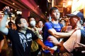A pro-Beijing demonstrator (center) scuffles with a so-called 'localist' protester in Hong Kong's busy Mong Kok district. Photo: Reuters