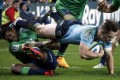 Bernard Foley of the New South Wales Waratahs is tackled by Highlanders winger Waisake Naholo during their Super Rugby semi-final match in Sydney on Saturday. The Highlanders beat the Tahs 35-17. Photo: Reuters