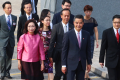 Chief Executive Leung Chun-ying (foreground, right) arrives with his wife and department secretaries. Photo: K.Y. Cheng