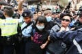 Protester Ng Lai-ying, 30, said when Chief Inspector Chan Ka-po stretched his arm to reach the strap of the bag on her shoulder, his hand landed on the upper part of her left breast on March 1 protest. Photo: Felix Wong