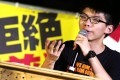Joshua Wong received news he would face charges as he was about to leave Hong Kong for a holiday in Japan. Photo: David Wong