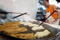 Mong Kok food vendor Tse Chi-keung, who prepares deep-fried breadsticks, will likely be affected by stricter laws now under public consultation. Photo: K. Y. Sheng