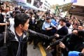 Police clash with localist groups during an anti-parallel goods trading protest in Yuen Long on March 1. A 17-year-old schoolboy accused of hitting a policeman with a restaurant door amid the chaos has been acquitted by a court. Photo: Felix Wong