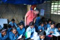 John Wood of Room to Read observes a class in the temporary learning centre in Shree Mandredhunga Primary School in Nuwakot. It is estimated that over one million  children in Nepal's earthquake-affected regions are studying in such makeshift centres. Photo: Rishi Amatya/Room to Read