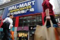 The chief executive and chairman of Walmart's Chinese e-commerce subsidiary Yihaodian have quit the company, it announced this week. Photo: Xinhua