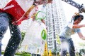 Residents of Kai Ching Estate collect fresh water from a temporary distribution pipe yesterday. The government ruled out lead tests at all estates. Photo: Dickson Lee