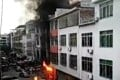 Black smoke pours from the home of a businessman in Pinghe county in China's Fujian province after the attack. Photo: Chinanews.com