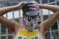A topless protester takes part in a demonstration against the corruption scandal engulfing Brazilian state-owned oil firm Petrobras on Monday. Photo: AFP