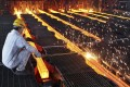 China's steel sector is estimated to have about 300 million tonnes of excess annual production capacity. Photo: Reuters