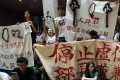 Protesters mass at the Education Ministry in Taipei on Friday. Photo: AFP