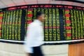More trading accounts have been frozen by Shanghai and Shenzhen stock exchanges for what they termed 'irregular trading' or 'hedging'.  Photo: Xinhua