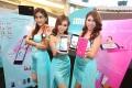Thai models promote iMI smartphones. Photo: SCMP Pictures