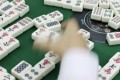 For many in Hong Kong, indoor pastimes don't get any better than mahjong - provided players can agree which rules to follow.