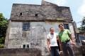 Chiu Ping-kan (left), elder brother of Chiu Ping-yin (right), poses for a photograph outside the fortified structure at No. 55 Ha Pak Nai Tsuen, Yuen Long. Photo: Bruce Yan