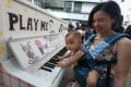 """Nine-month-old Cheung Lok-yan and her mother attend the """"Play Me, I'm Yours"""" launch event at PMQ in Central. Photo: David Wong"""