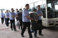 Chinese economic fugitives arrested in Indonesia pictured In June as they are escorted from Beijing's international airport. Hundreds of Chinese fugitives have been repatriated since last year. Photo: Xinhua