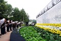 Mourners pay respects at a ceremony in a Binhai New Area park. Photo: Xinhua