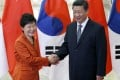 South Korea's President Park Geun-Hye pictured with Xi Jinping at an Apec summit in Beijing last year. Photo: AP