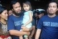 Philippine coastguards Rod Allain Pagaling (second left) carries his daughter Allian with wife Judith and his colleague Gringo Villaruz (right) are reunited with their families in Manila. Photo: AFP