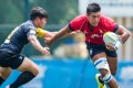 Hong Kong captain Richard Lewis leads from the front on the first day of the second leg of the 2015 Asia Rugby U20 Sevens Series at King's Park on Friday. Photo: HKRU