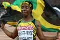 Jamaica's Shelly-Ann Fraser-Pryce celebrates after winning the women's 100 metres at the World Athletics Championships in Beijing. Photo: Xinhua