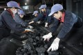 Workers sort coal at a mine in Anhui province in eastern China. The nation is the world's main user of the fuel and the biggest producer of greenhouse gases. Photo: Reuters