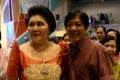 Philippine Senator Ferdinand Marcos (R) smiles with his mother, former first lady Imelda Marcos, during the 2014 birthday celebration of the former first lady. Photo: AFP