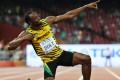 Jamaican sprinter Usain Bolt celebrates winning the 200m men's world championship title with his signature pose at the Bird's Nest stadium in Beijing. Photo: EPA