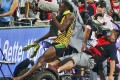 Usain Bolt escaped with minor cuts. Photo: Reuters