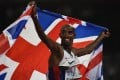 Britain's Mo Farah celebrates winning the final of the men's 5,000 metres at the world championships in Beijing. Photo: AFP