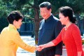 South Korean President Park Geun-hye (L) is welcomed by Chinese President Xi Jinping (C) and his wife Peng Liyuan at Tiananmen Square. Photo: EPA
