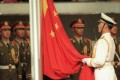 The Chinese flag is raised during the handover ceremony in 1997. The Hong Kong Observers supported China's resumption of sovereignty over Hong Kong, a stance welcomed by Beijing. Photo: AP