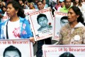 Relatives of the 43 missing Iguala students join a protest to mark the eleven-month anniversary of their disappearance in Mexico City. Photo: Reuters