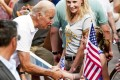U.S. Vice President Joe Biden shakes hands with a girl during the annual Allegheny County Labor Day Parade  in Pittsburgh, Pennsylvania. Photo: AFP
