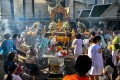 People pray at the site of the deadly bomb blast in Bangkok. Photo: Reuters