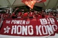 A Hong Kong fan waves a flag at the World Cup qualifying match against Qatar in Hong Kong. Photo: Reuters
