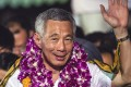 Singapore Prime Minister and secretary general of the ruling People's Action Party Lee Hsien Loong celebrates at the Toa Payoh stadium where supporters have gathered to hear the announcements of the results in the Singapore General election. Photo: EPA