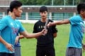 Sprinter Su Bingtian (centre) instructs Hong Kong sprinters on baton changes during a clinic at the HK Sports Institute. Photo: Jonathan Wong