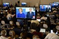 Media watch an exchange between US Republican presidential candidates Donald Trump and Carly Fiorina during the debate. Photo: EPA