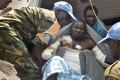 Rwandan UN peacekeepers evacuate a burn victim to the capital Juba by plane for medical treatment. Photo: AP