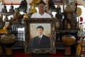 Red shirt movement leader Kwanchai Praipana poses with a photo of former PM Thaksin Shinawatra at his office in Udon Thani, Thailand. Photo: Reuters