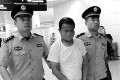 Ding Qingping is returned to Chinese custody. Photo: sinanews.com