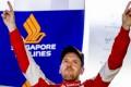 Ferrari driver Sebastian Vettel celebrates winning the Singapore Grand Prix. Photo: EPA