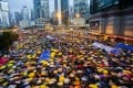Pro-democracy protesters open their umbrellas for 87 seconds on October 28, marking 87 rounds of tear gas that police fired at unarmed demonstrators a month ago at exactly the same location in Admiralty outside government headquarters. Photo: EPA