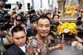 Hong Kong actor Simon Yam smiles during his visit to the Erawan shrine in central Bangkok, Thailand. Yam's visit is part of the Tourism Authority of Thailand's (TAT) campaign to restore tourist confidence. Photo: Reuters